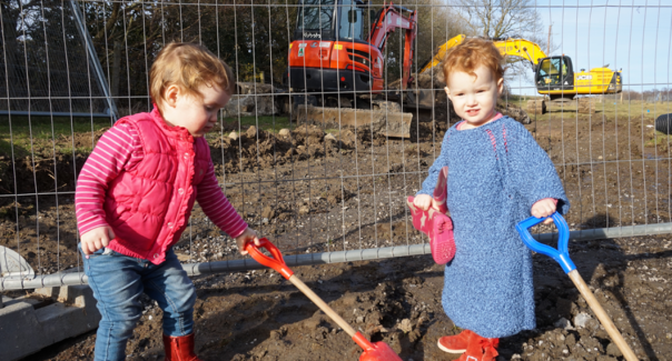The twins lend a hand with digging.