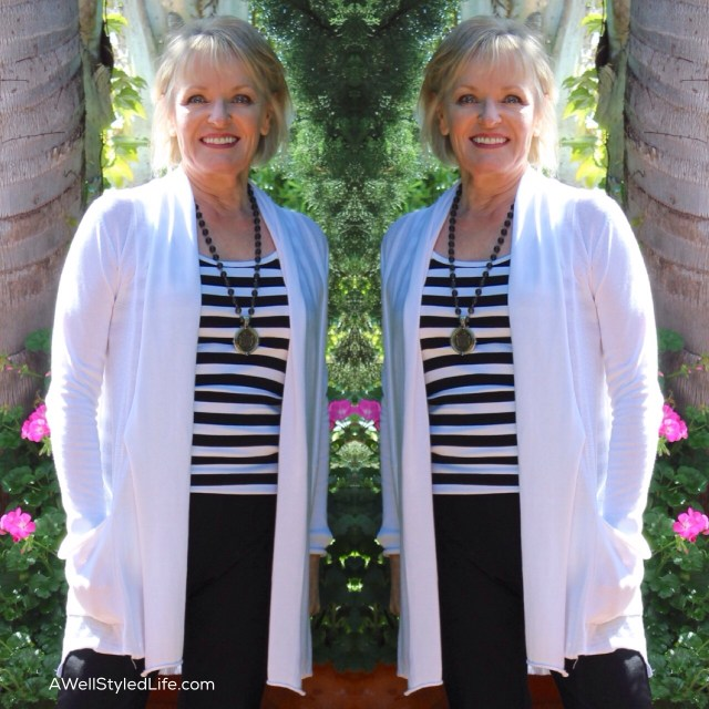 Wearing a longer necklace with a tunic sweater helps you appear taller.