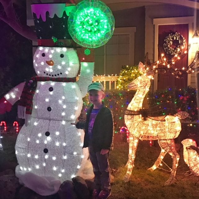 Jennifer Connolly of A Well Styled Life seeing the Christmas Lights with her grandson