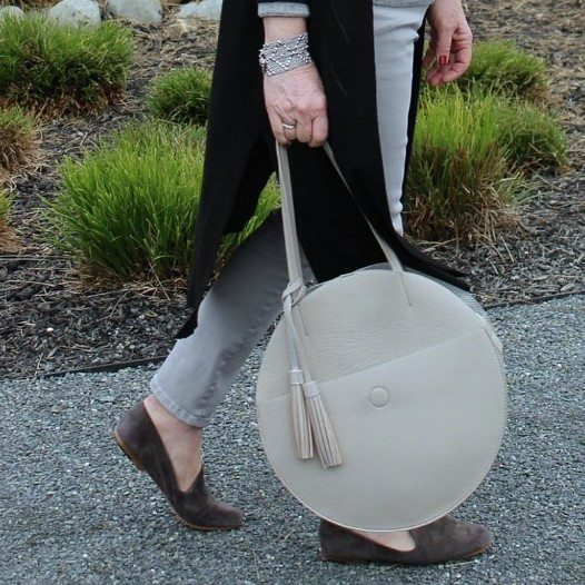 Jennifer Connolly of A Well Styled Life wearing tassel bag from Anthropologie