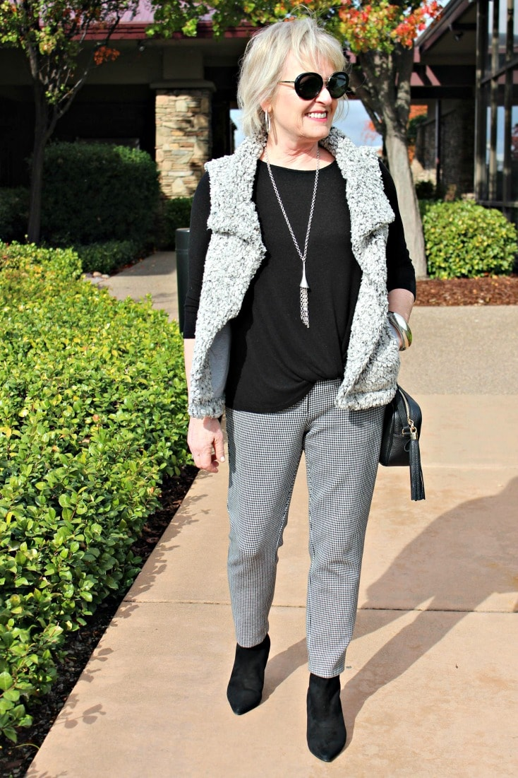 jennifer connolly of a well styled life styling gray vest with gingham pants and black booties
