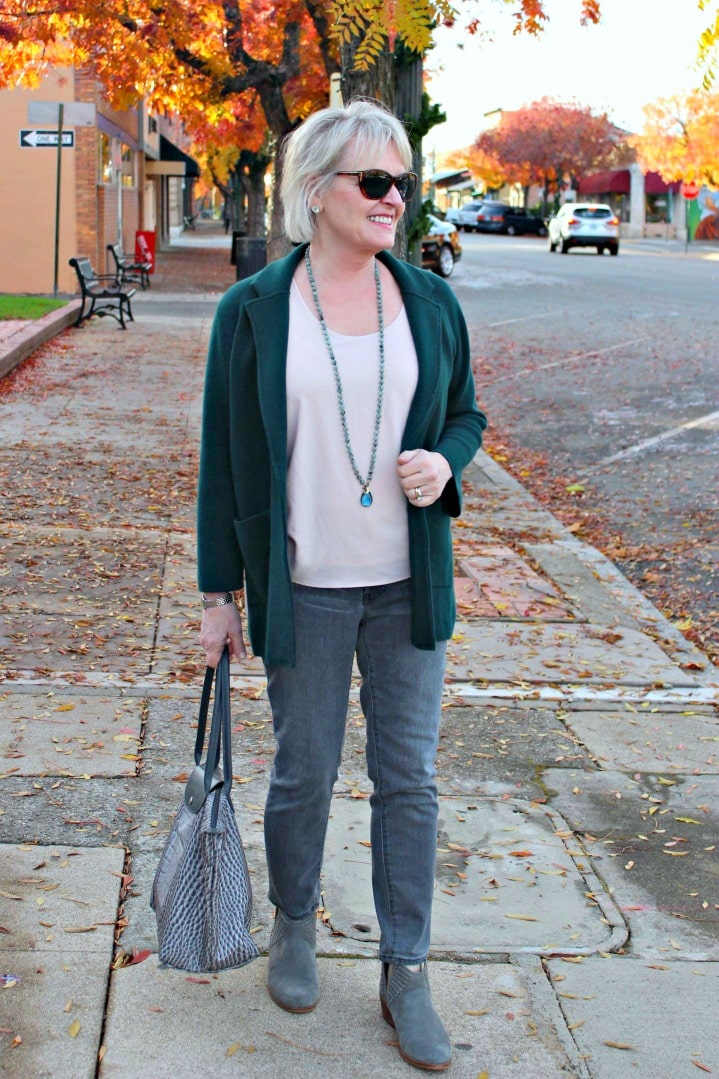 jennifer connolly of a well styled life wearing green sweater coat over gray jeans and gray booties