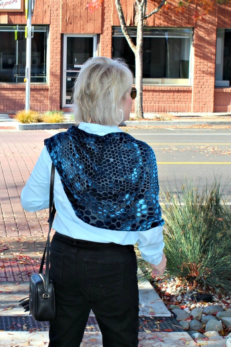 jennifer connolly from a well styled life wearing blue velvet burnout cape with leopard print pattern