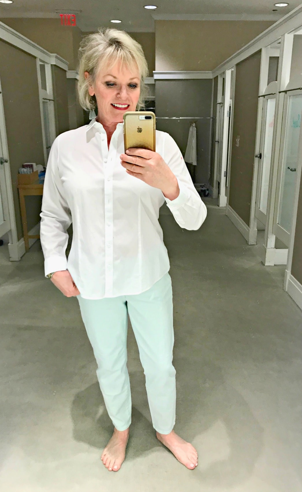 Jennifer of A Well Styled Life wearing classic white shirt and colored jeans