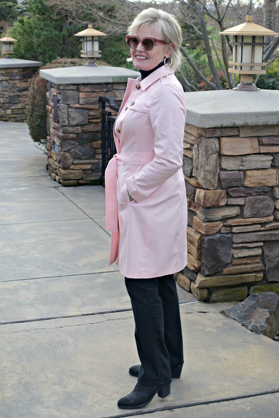 Jennifer Connolly of A Well Styled Life wearing NYDJ Marilyn jeans in black with Talbots Modern Trench coat in pink