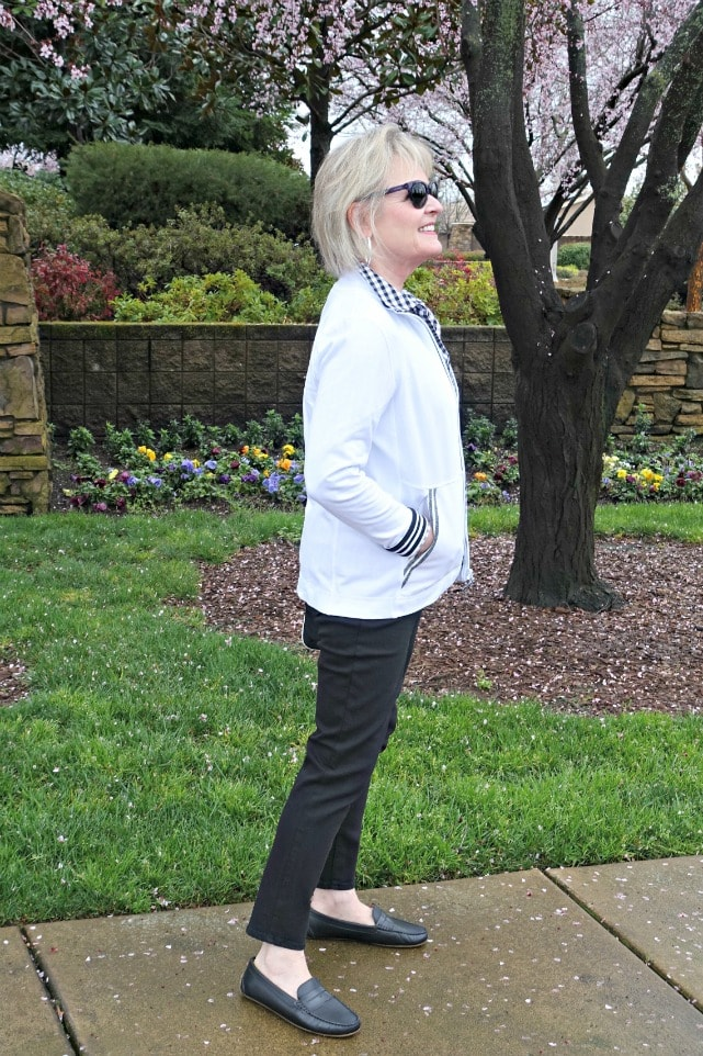 T Talbots yoga jacket and Talbots never fade black jeans on Jennifer Connolly in front of spring flowers