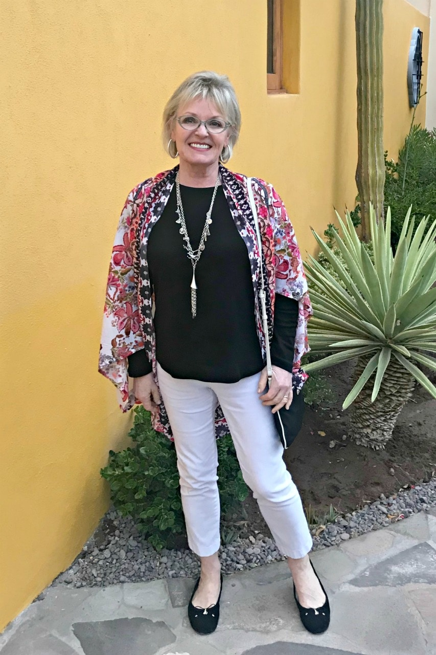 Jennifer Connolly wearing colorful wrap over black and white outfit in Loreto Bay Mexico