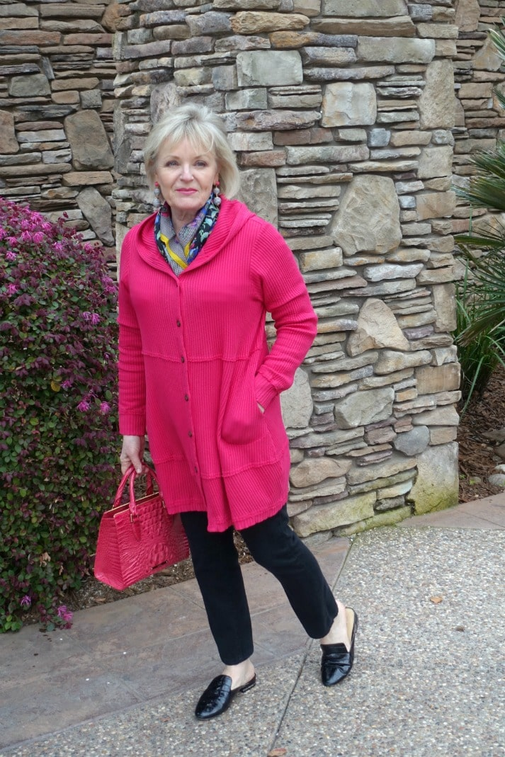 pink hoodie over black jeans with scarf and pink handbag on over 50 style blogger Jennifer Connolly