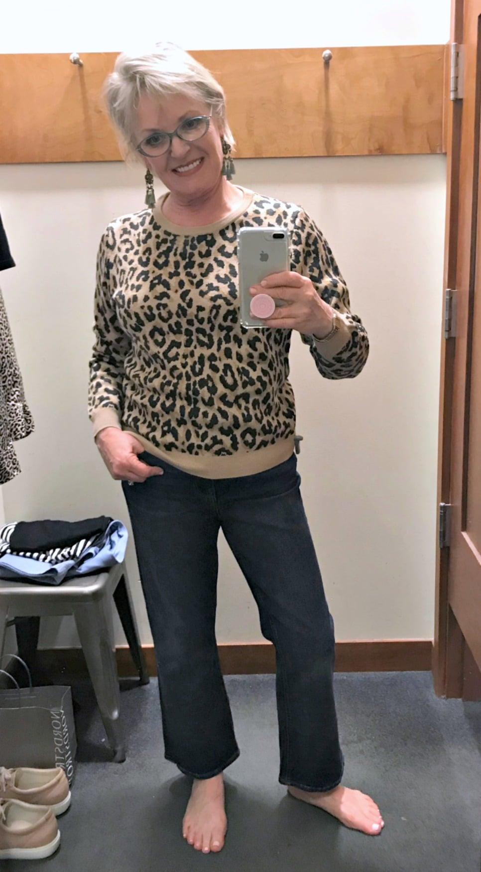 Jennifer of A Well Styled Life wearing J.Crew merino sweater in leopard print with cropped flares