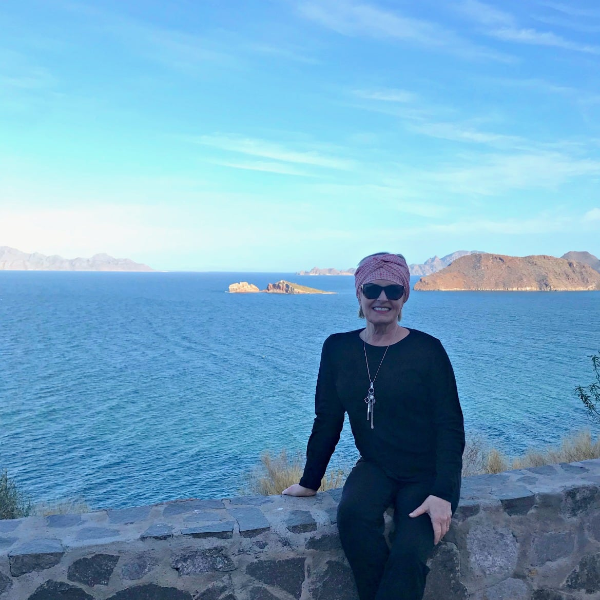 Jennifer Connolly of A Well Styled Life on seawall at the Sea Of Cortez, Mexico