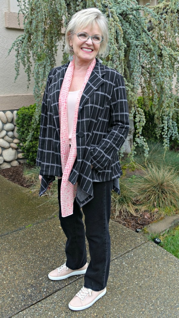 Jennifer Connolly of A Well Styled Life wearing gray plaid jacket and blush top