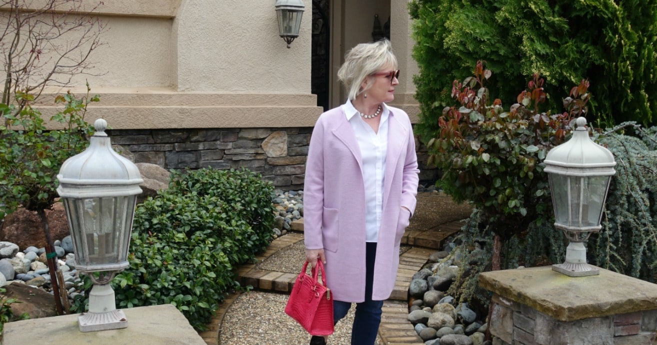 casual outfit with wysterai colored sweater blazer from J.Crew, white blouse and blue jeans on over 50 style blogger