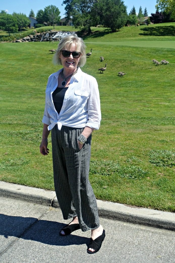 linen riviera pant with white shirt tied at waist and black sandals worn by Jennifer Connolly of A Well Styled Life