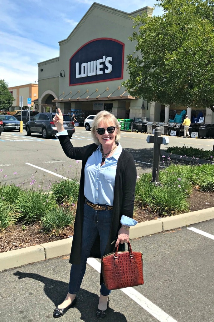 Jennifer Connolly of A Well Styled Life outside Lowes wearing black duster sweater over denim shirt and jeans