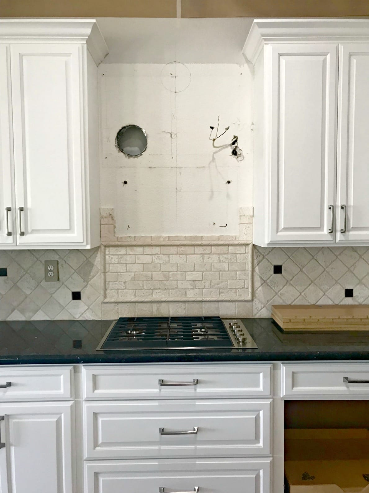white kitchen cabinets before hood is installed on A Well Styled Life