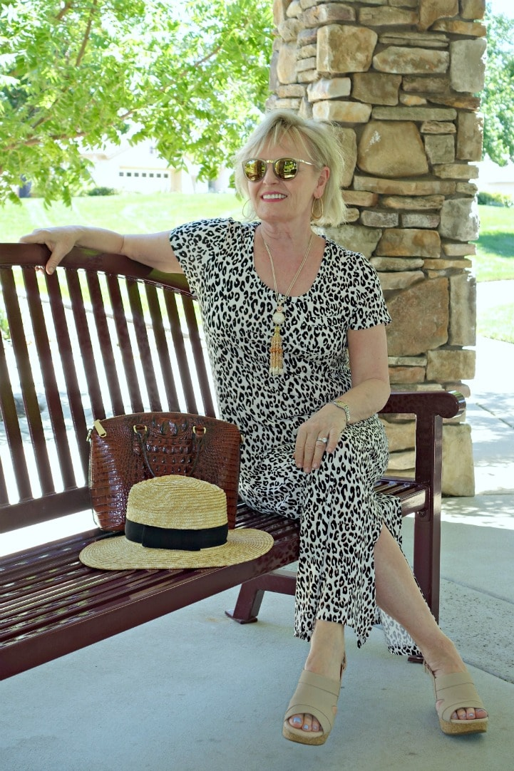 Jennifer Connolly of A Well Styled life wearing leopard with straw hat and Clarks sandals