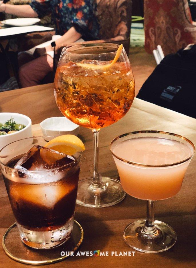 Negroni (₱495). Bombay Sapphire, Campari, Mancino Rosso, orange bitters, grapefruit bitters. Aperol Spritzer (450). Aperol, Schweppes Soda Water, prosecco