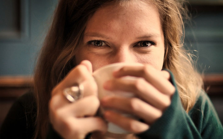 Woman cozy with cup