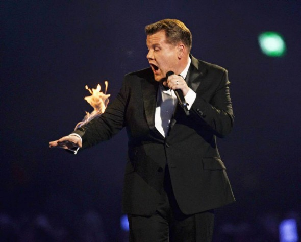 James Corden with his arm on fire