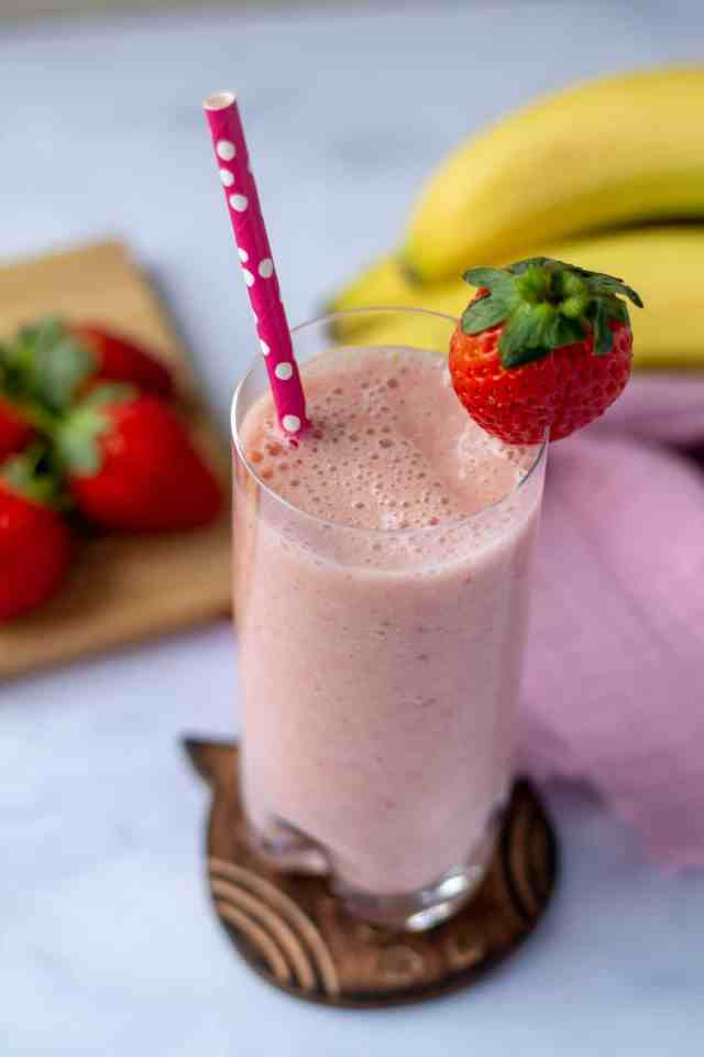 Strawberry Banana Smoothie with strawberry on rim