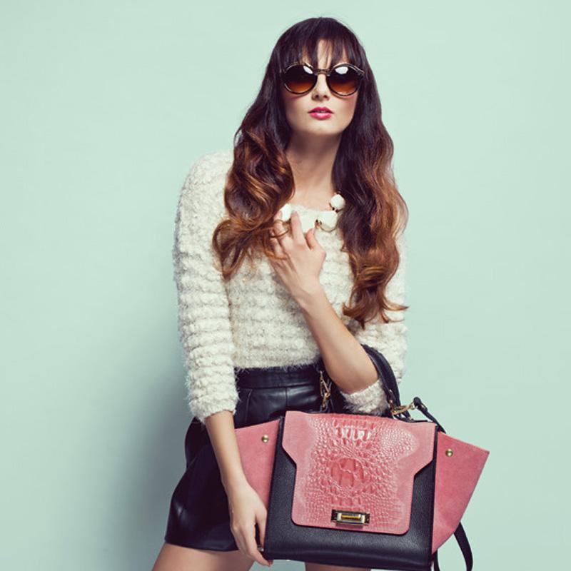 woman wearing sunglasses with handbag