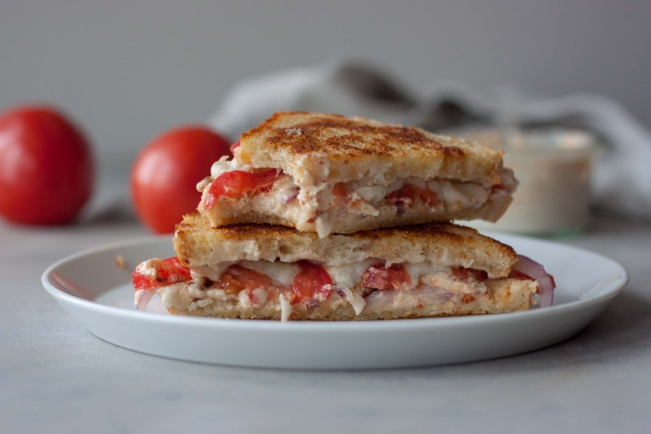 Grilled Cheese Tomato Sandwich on sourdough with bite