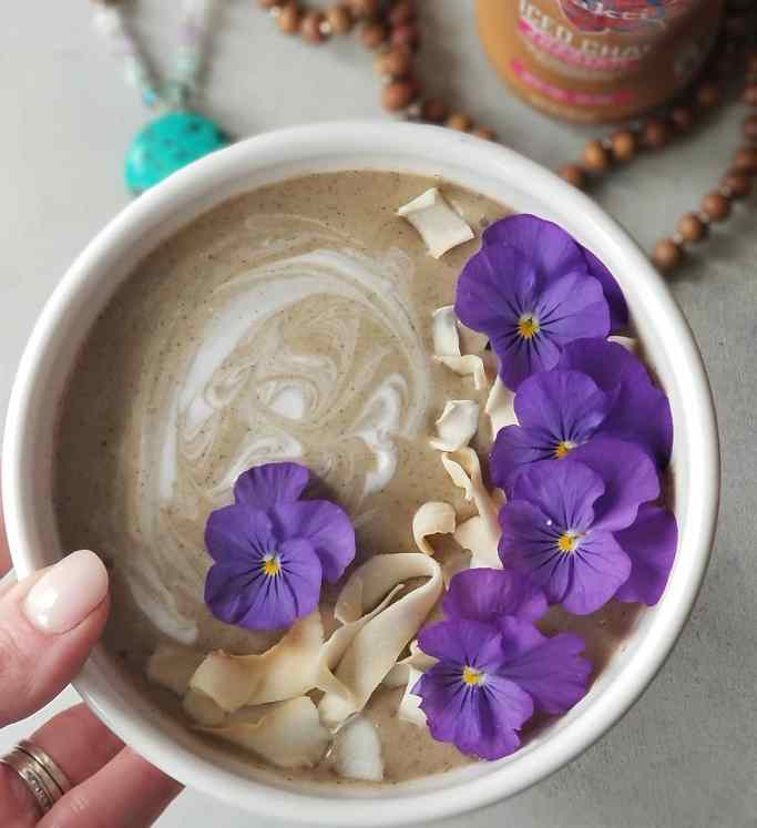 Sweet Chai Of Mine Smoothie Bowl with coconut yogurt, toasted coconut chips, and edible flowers