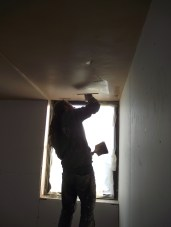 Skilled plasterer at work