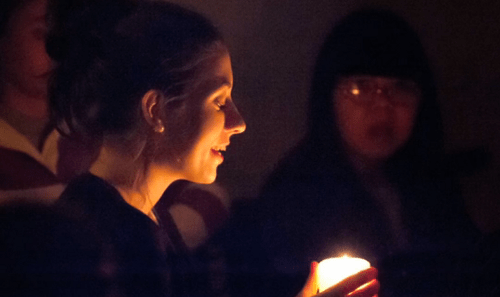 Passing the candle after supper. Photo credit: Brian A. Taylor Photography