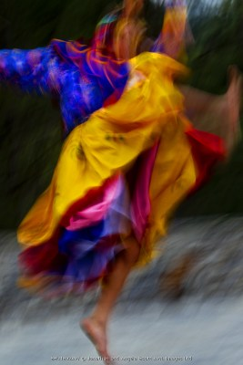 Asia, Amankora Resort, Paro, Bhutan. Dancing is an important part of all major festivals in Bhutan depicting important events in peoples lives and honoring the life and work of Lord Buddha.