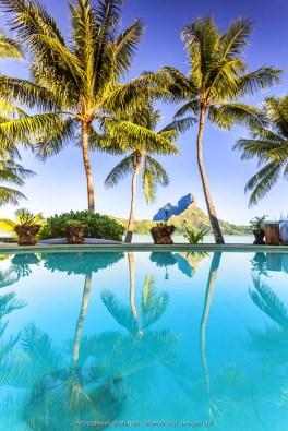 Mount Otemanu reflected in the swimming pool of a luxury resort, Bora Bora, French Polynesia