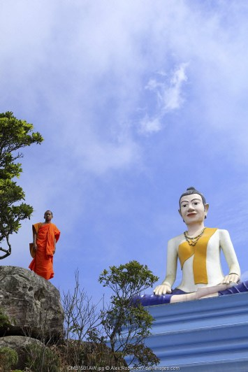 Asia, South East Asia, Cambodia, kampot, Phnom Bokor national park, buddhist monk and statue of Lok Yeay Mao, the Goddess Protector of the Sea
