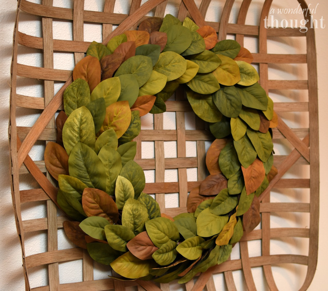 Make your own DIY magnolia wreath just like on Fixer Upper! Perfect for your farmhouse decor | awonderfulthought.com
