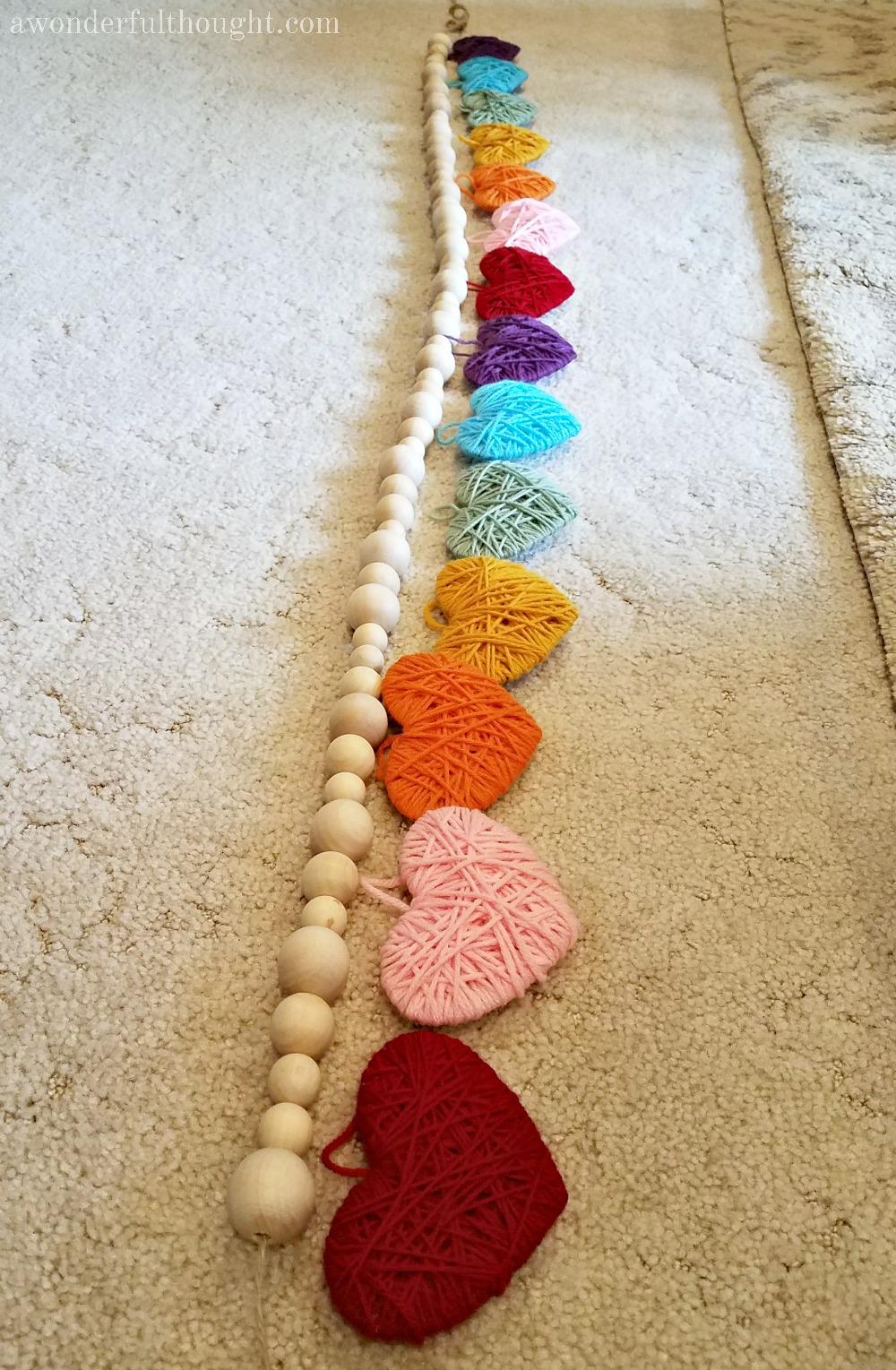 Mulitcolored Yarn Heart Garland #heartgarland #valentinesdaydecor #valentinesday #awonderfulthought