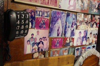 Ho and his wife have decorated the walls of their home with family pictures. Ho is the tenth of 12 siblings, who, according to one of his sisters, all have more than 10 children.