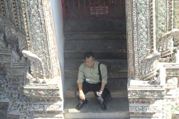 Ithidej Sarunsiri, who works as a tour guide in Bangkok, finds a place in the shade at the Wat Arun Temple to hide from the hot Thai sun on January 3, 2013.
