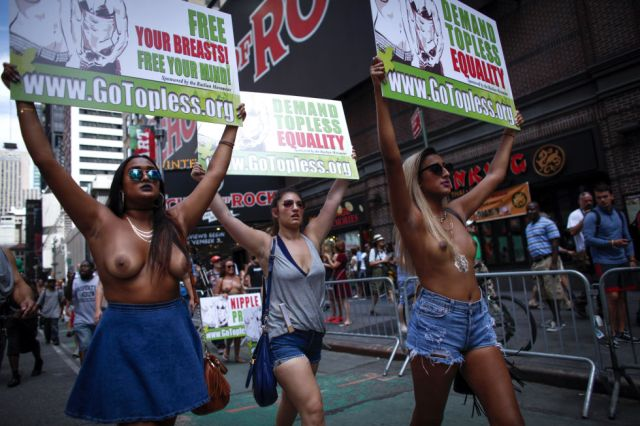 A Word with You Press keeps abreast of all the parades. This one New York recently. Over the Topless?