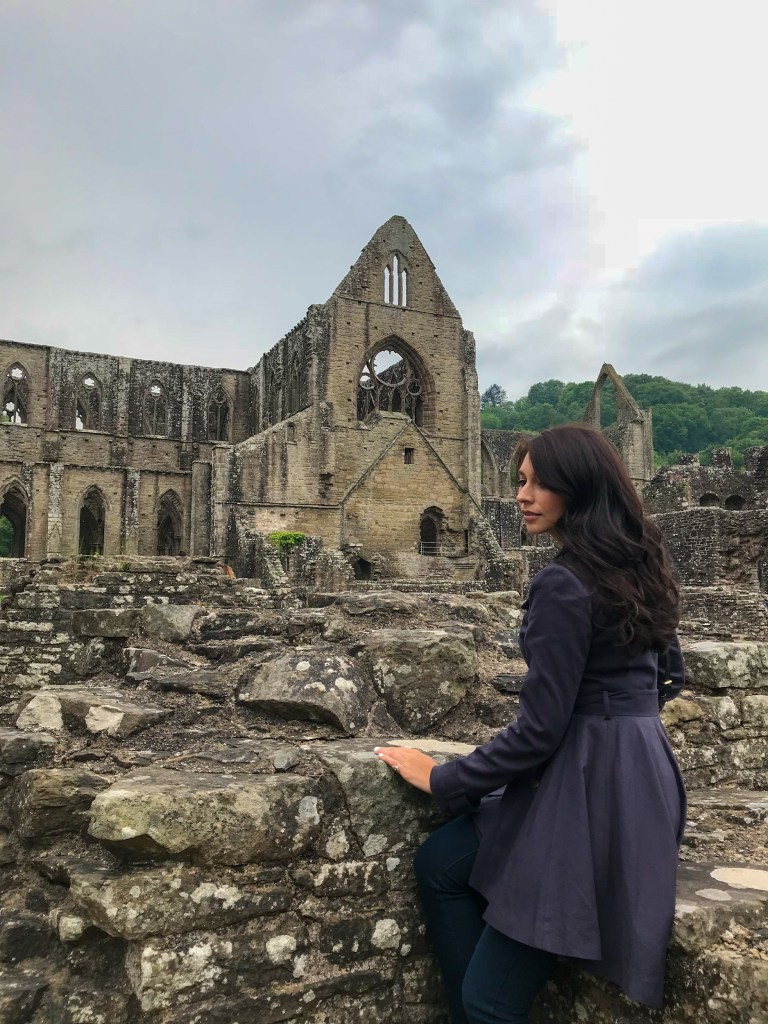 Woman in front of Tintern Abbey in Wales