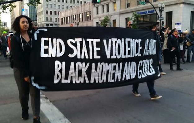 Protesters hold a sign at a #SayHerName protest in Oakland. (Photo credit: BlackOUT Collective, May 2015)