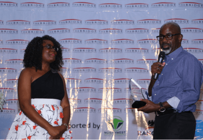 Mary Olushoga receiving award from Senator Liyel Imoke