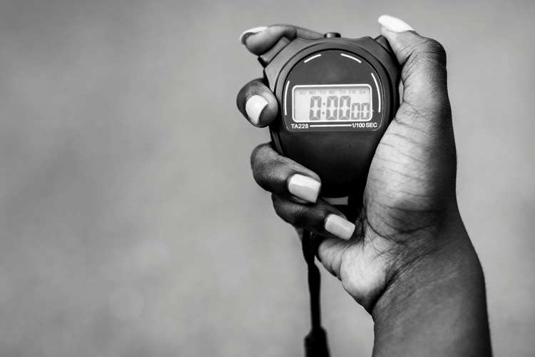 Woman's hand holding a stopwatch