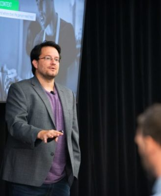 JD Dillon, Chief Learning Architect at Axonify, speaking at a conference