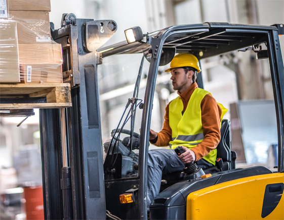 Warehouse worker using forklift