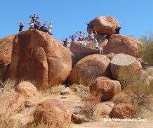 The tour group on top of some of the Devils Marbles giving a sense of the impressive scale