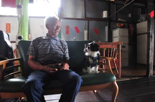 Ho comes back under the roof to have a rest at noon and talks to his dog, Ar Dic, which he adopted four years ago.
