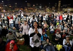 Supporters react as they watch projections on television monitors at the election night party for Democratic presidential candidate Sen. Barack Obama, D-Ill., at Grant Park in Chicago, Tuesday night, Nov. 4, 2008. (AP Photo/Alex Brandon)