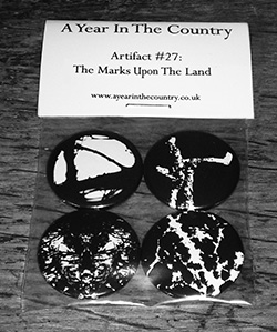 Artifact-27-250-The-Marks-On-The-Land-badge-set-front-of-badge-set-A-Year-In-The-Country-copy-1