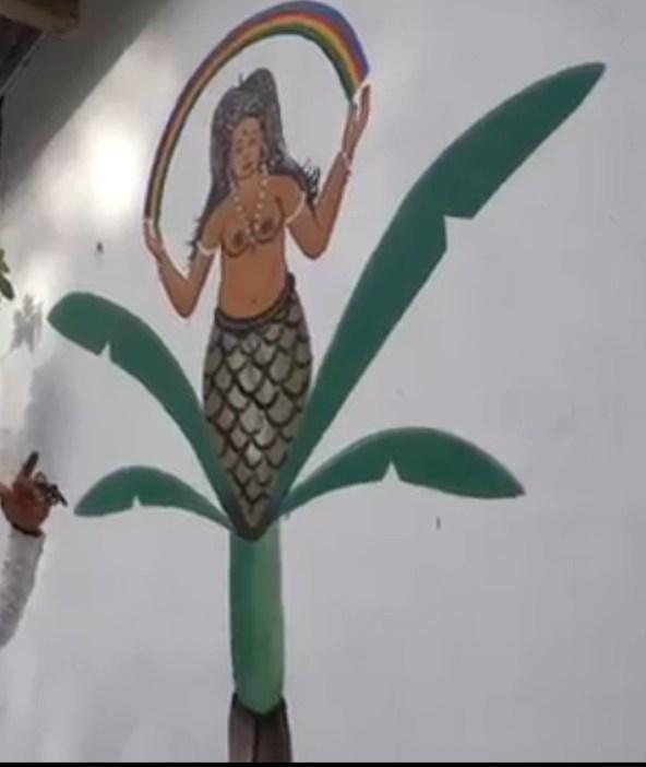 Gbadu on wall in temple in Benin