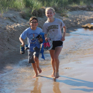 Campers running on the beach