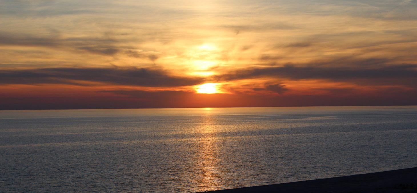 Sun sets over Lake Michigan at Miniwanca beach